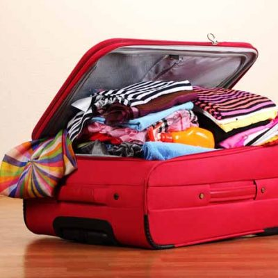 serezniy111200593.jpg - open red suitcase with clothing in the room