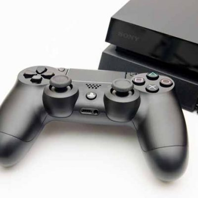 CLUJ-NAPOCA, ROMANIA - 25 FEBRUARY: Illustrative editorial image of Sony Playstation 4 console with Dualshock 4 controller on a white isolated background suggesting new technology in gaming hardware with a modern design with the logos