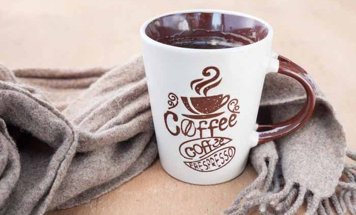 coffee Mug with a scarf, winter concept